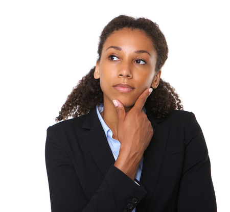 Close up portrait of a young businesswoman thinking on isolated white background