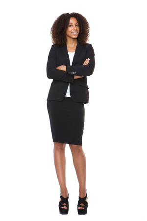 Full body portrait of a young business woman smiling on isolated white