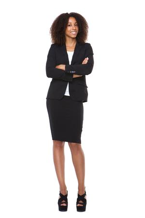 Full body portret van een jonge zakenvrouw glimlachen op geïsoleerde witte
