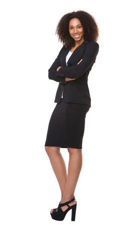confident: Full length portrait of an african american business woman smiling on isolated white