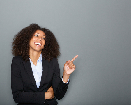 Portrait of a young african american business woman pointing finger