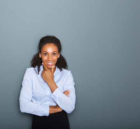 Close up portrait of a friendly young business woman thinking