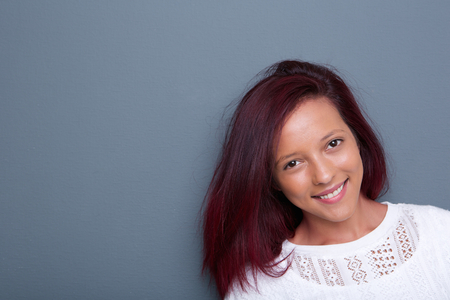 fray: Portrait of a smiling mixed race woman on fray background