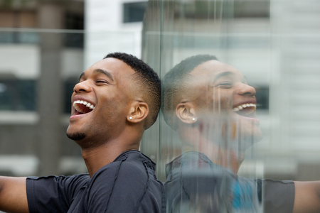 Close up portrait of a happy man laughing outdoors photo