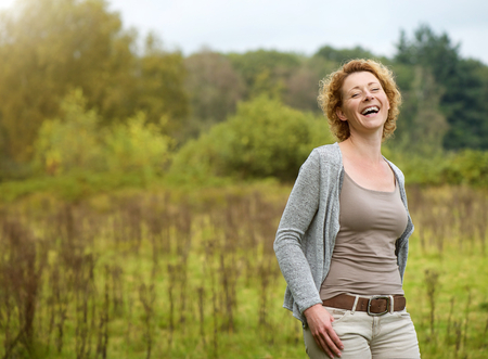 Portrait of a beautiful woman laughing in the countryside photo