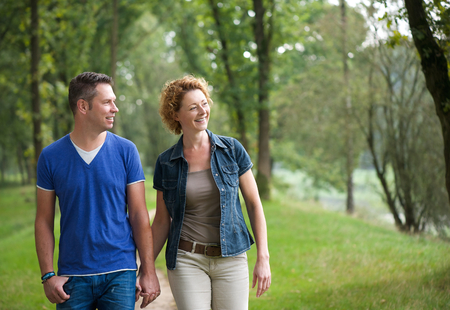 Portrait of a happy couple walking together outdoors photo