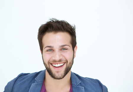 young man smiling: Close up portrait of one smiling man with beard on white background  Stock Photo