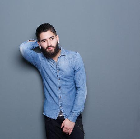 male fashion: Portrait of a male fashion model posing on gray background