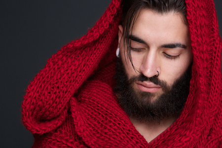 Close up portrait of a male fashion model with red scarf