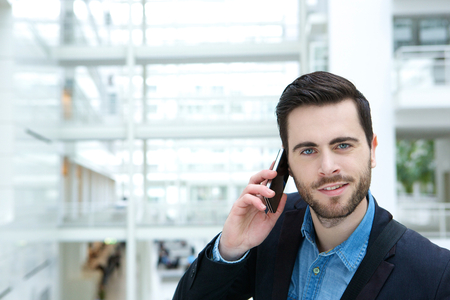 cute guy: Close up portrait of a cute guy calling by mobile phone Stock Photo