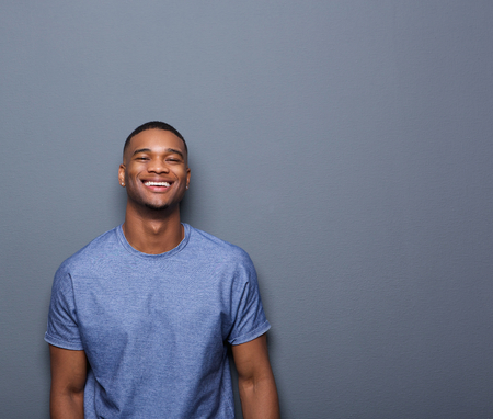 Portrait of a cheerful young african american man posing on gray background Stok Fotoğraf - 32077755