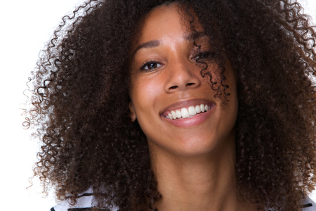 close up woman: Close up portrait of an attractive young african woman smiling Stock Photo
