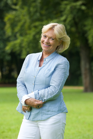 Portrait of a happy senior woman smiling in the park