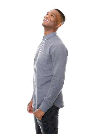 happy young man: Portrait of a handsome african american man laughing on isolated white background
