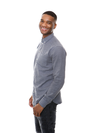 Portrait of a handsome african american man smiling on isolated white background Stock Photo