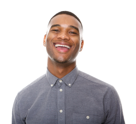 face expressions: Close up portrait of a happy black man laughing on isolated white background