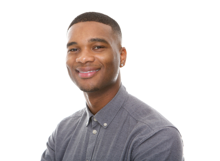 Close up portrait of a charming young african american man smiling on isolated white background Stock Photo