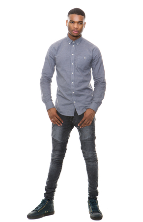 man isolated: Full length portrait of a handsome african american man standing on isolated white background