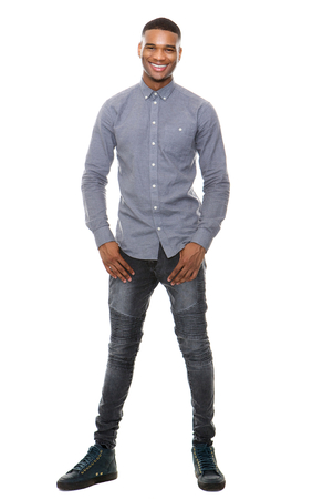 Full length portrait of a cool black guy smiling on isolated white background Archivio Fotografico