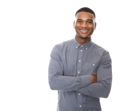 Portrait of a modern young black man smiling with arms crossed on isolated white background