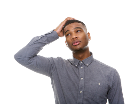 scratching head: Close up portrait of a confused african american man isolated on white background Stock Photo