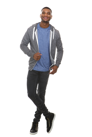 isolated on white: Full length portrait of a cool young black man smiling on isolated white