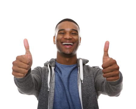 thumbs up sign: Close up portrait of a young african american man smiling with thumbs up sign