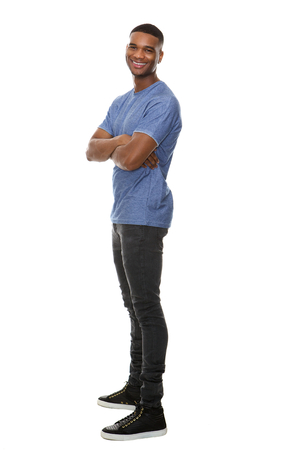 Full length side view portrait of a cheerful african american man Stock Photo