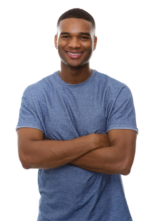 Portrait of a handsome african american man smiling with arms crossed on isolated white background