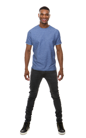 Full body portrait of a handsome young african american man smiling on isolated white background