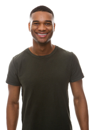 Portrait of a smiling young man with green t-shirt Imagens