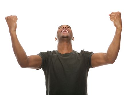 lottery win: Portrait of a cheerful young man shouting with arms raised in success