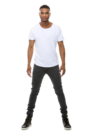 full face: Full length portrait of a handsome african american male fashion model posing on isolated white background