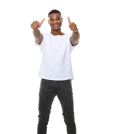 sign up: Portrait of a cool guy smiling with thumbs up sign on isolated white background