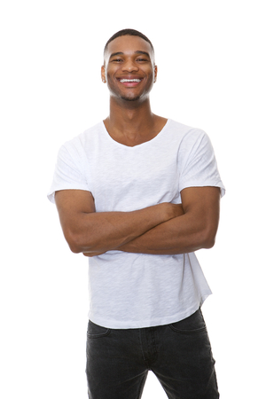 young man smiling: Portrait of a friendly young man smiling with arms crossed on isolated white background