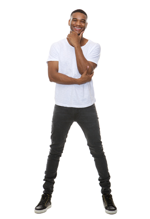 Full length portrait of a confident young african american man standing on isolated white background
