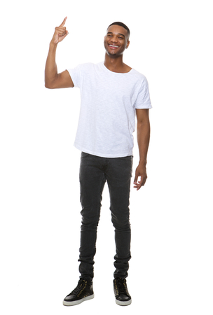 white person: Full length portrait of a smiling man pointing finger showing copy space