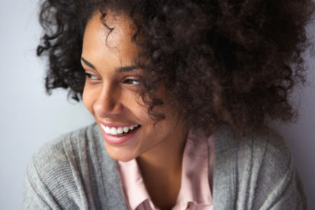 happy african woman: Close up portrait of a happy african american woman smiling