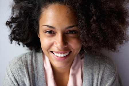 happy black woman: Close up portrait of a beautiful african american woman face smiling