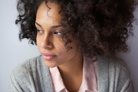serious: Close up portrait of one attractive african american woman Stock Photo