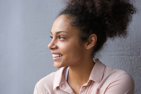 face side: Close up portrait of a beautiful african american woman smiling