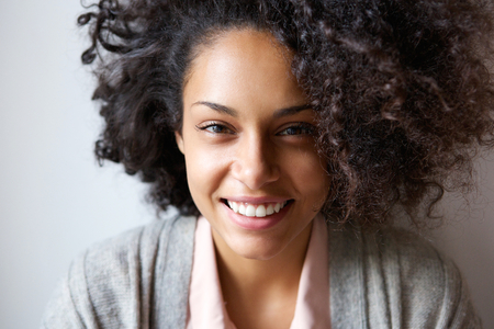 smiles: Close up portrait of a beautiful young african american woman smiling Stock Photo
