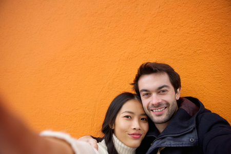 Close up portrait of a happy young couple taking selfie photo