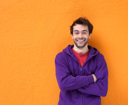 man relax: Portrait of a friendly guy smiling with arms crossed Stock Photo