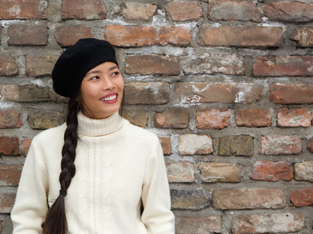 Close up portrait of an attractive young woman smiling with beret hat photo