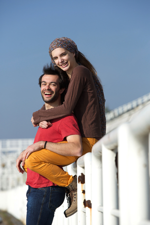 Portrait of a young couple smiling and having fun outdoors photo