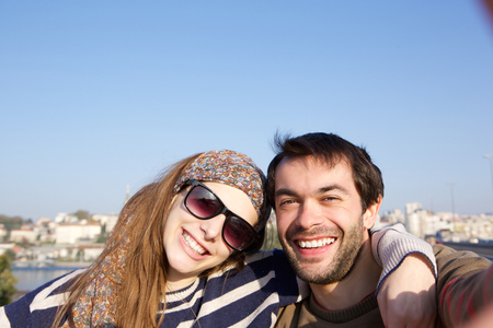 Selfie of young man and woman smiling photo