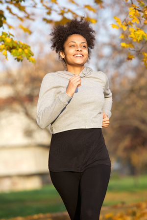 Portrait of a sporty young woman jogging in the park photo