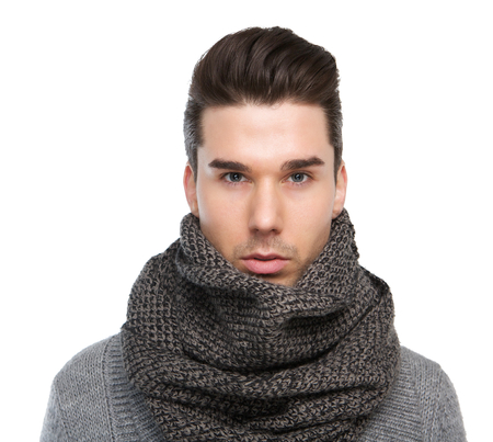 studio model: Close up portrait of a male fashion model posing with gray wool scarf Stock Photo