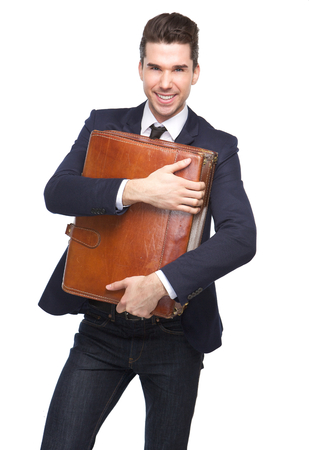 Portrait of a happy young business man holding leather bag on isolated white background photo